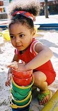 toddler girl in sandbox