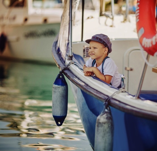 toddler on a sailboat
